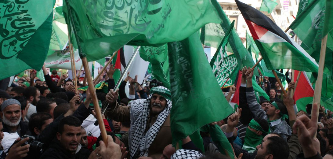 Palestinian supporters of Hamas attend a rally marking the 25th anniversary of the Islamist movement's foundation