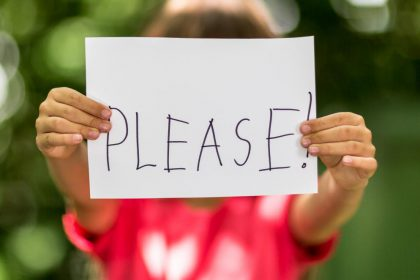 child-with-please-sign