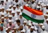 A Muslim man waves an Indian flag during a march to celebrate India's Independence Day in Ahmedabad