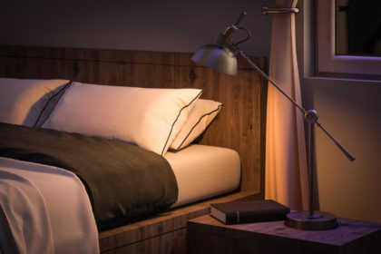 bedroom interior with book and reading lamp