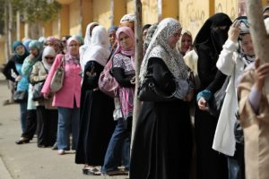 Women line up waiting to cast their vote at a polling station in Cairo