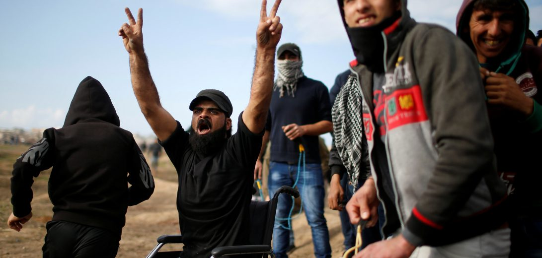 Wheelchair-bound Palestinian demonstrator Ibrahim Abu Thurayeh gestures before he was killed during clashes with Israeli troops on Friday at a protest near the border with Israel in the east of Gaza City