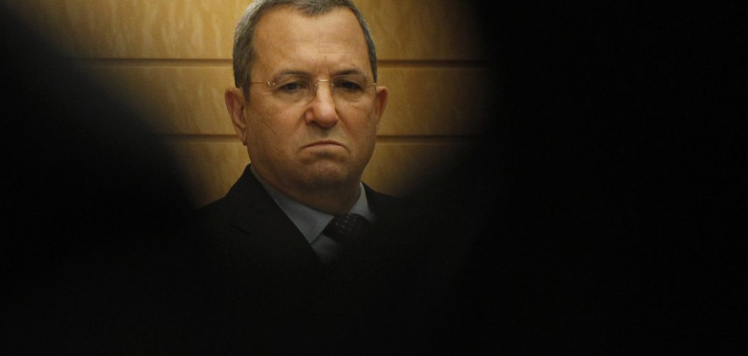 Israeli Defence Minister Barak is seen between reporters before a meeting with Japanese Prime Minister Noda in Tokyo