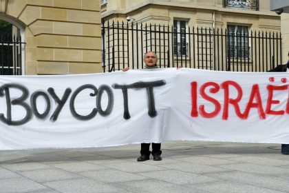 Pro-Palestinian activists hold a banner