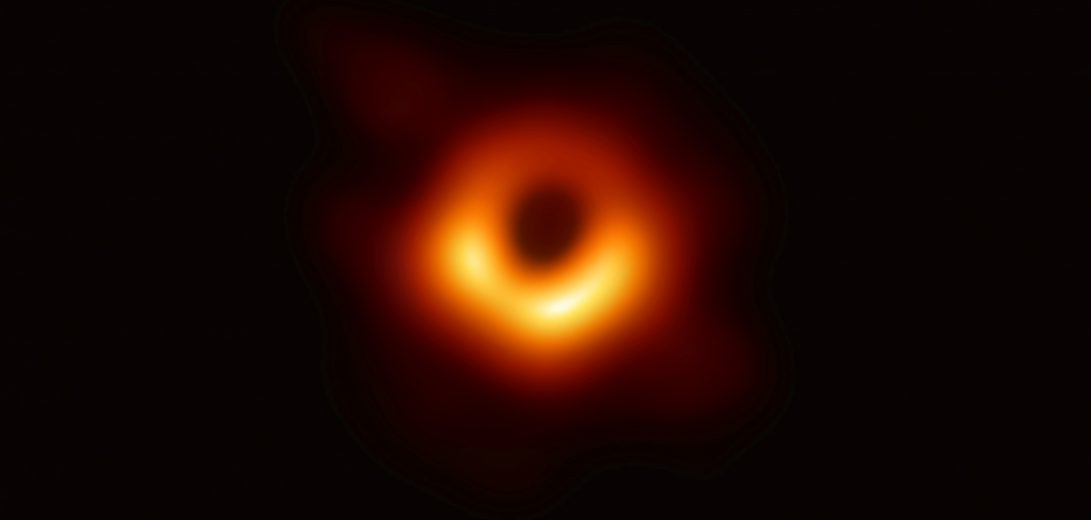 Handout photo of the first ever photo a black hole, taken using a global network of telescopes, conducted by the Event Horizon Telescope (EHT) project