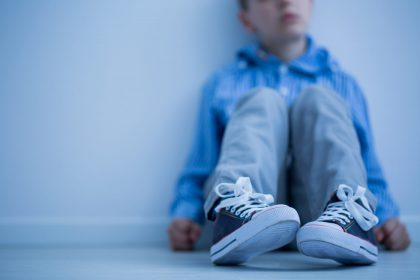 Boy sitting on a floor