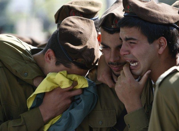 Israeli soldiers mourn during the funeral of their comrade Ilan Sviatkovsky in Rishon Letzion